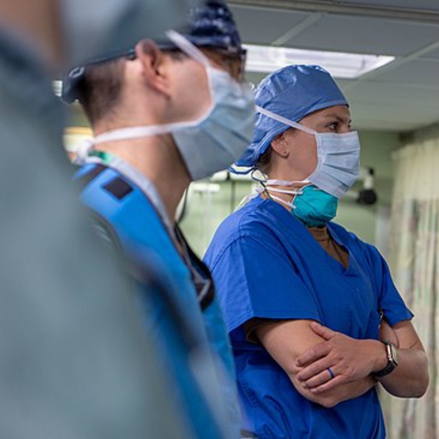 Medical staff listening with arms crossed